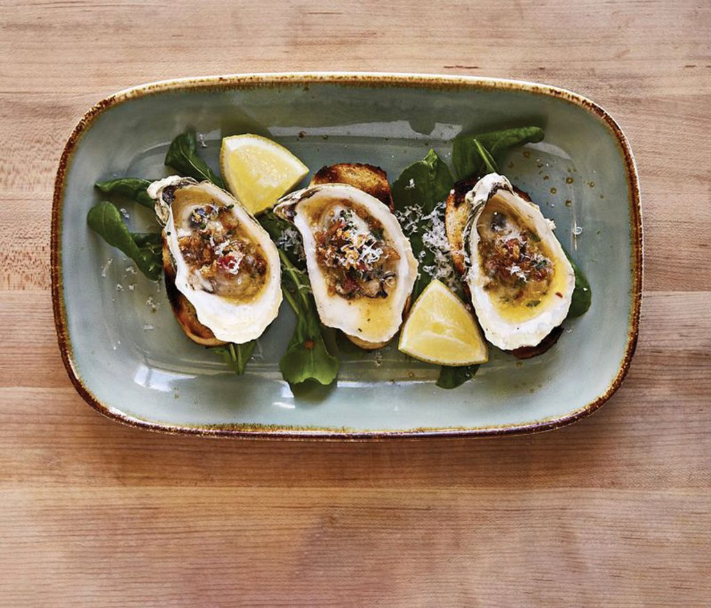 Grilled Wianno oysters at 3030 Ocean at the Harbor Beach Marriott Resort and Spa. Photo by Michael Pisarri/Courtesy