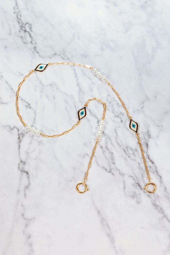 """Ashley Finestone's Miami Mask Chains come in a variety of collections such as """"Evil Eye"""" above and """"Per Suede"""" below."""
