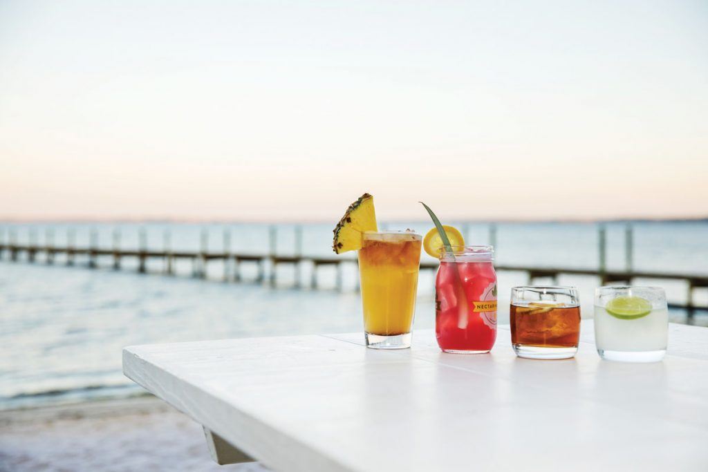 Expect fresh Gulf seafood and drinks with a view in Florida's Panhandle, especially in the town of South Walton, where the culinary scene ranges from upscale to breezy, toes-in-the-sand spots. Photo by Collis Thompson