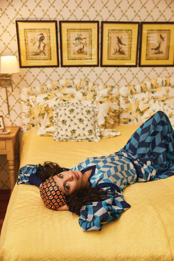 Lilly Reilly wearing Gucci geometric GG cardigan, chevron vest, chev- ron midi skirt; Tory Burch scarf photo by Gabor Jurina